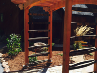 Redwood arbor with whiskey barrel staves