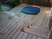 Redwood Deck with Built-in Hot Tub and Curved Stairs