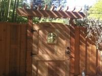 Custom gate with peep window and arbor